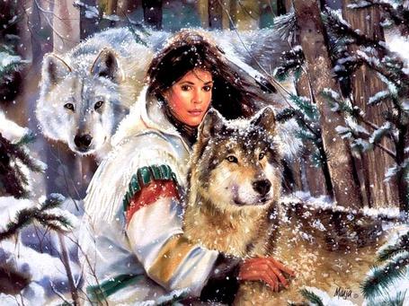 Фото Девушка с волками в зимнем лесу (Maija)