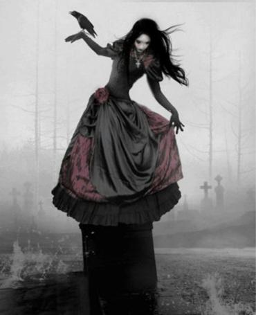 Фото Девушка с птицей  на кладбище