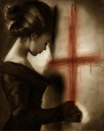 Фото Рисует крест кровью
