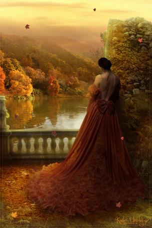 Фото Девушка в красивом платье смотрит на воду