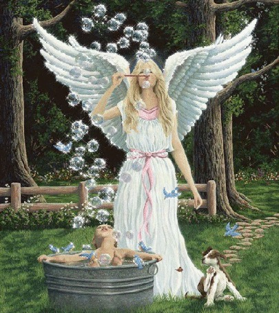 Фото Девушка-ангел пускает мыльные пузыри