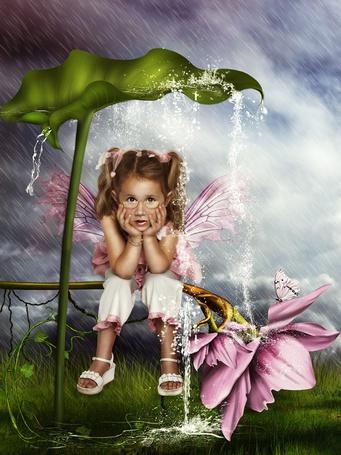 Фото Маленькая фея спасается от дождя под большим листом лопуха