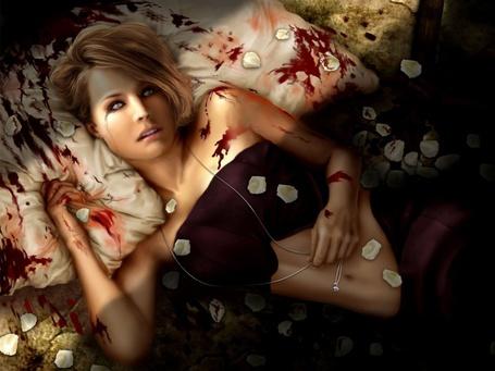 Фото Мёртвая девушка в лепестках роз