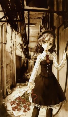 Фото Девочка с букетом красных роз в заброшенном доме