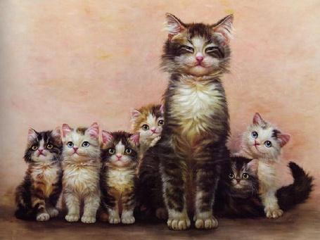 Фото Кошка со своими котятами