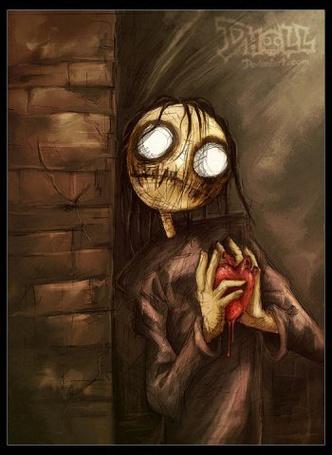 Фото Жуткая тряпичная кукла с кровоточащим сердцем в руках (© Шепот_дождя), добавлено: 19.03.2011 22:10