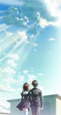 Фото Парень с девушкой любуются на солнечное небо