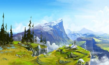 Фото Странник стоит у обрыва и смотрит на горы