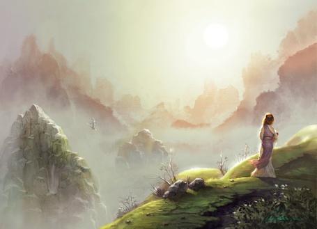 Фото Девушка стоит у обрыва и смотрит на рассвет