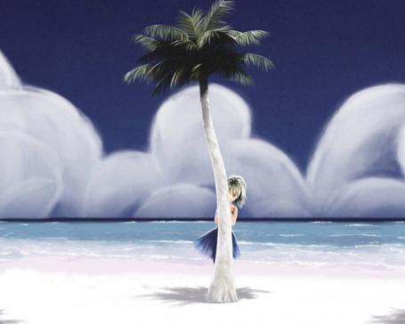 Фото Девочка прячется за пальмой