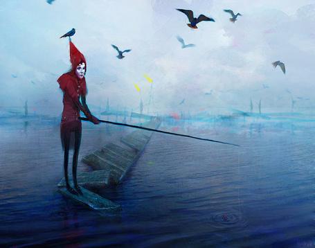 Фото Арлекин одиноко ловит рыбу в бездонном озере.