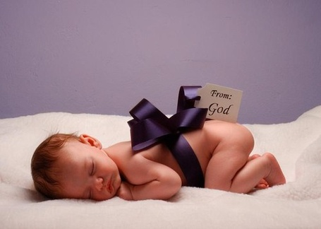 Фото Новорожденный с бантиком спит (From: God)