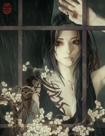 Фото Девушка смотрит в окно на дождь