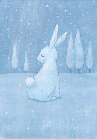 Фото Белый кролик под снегопадом