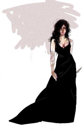 Фото Девушка в черном платье держит в руке нож,на ее руке и плече сделаны тату