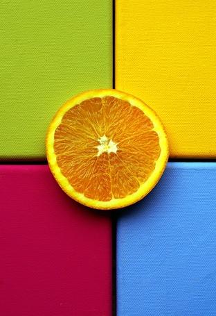 Фото Апельсиновая долька на пересечении зеленого, желтого, розового и голубого цветов (© Radieschen), добавлено: 28.11.2011 05:40
