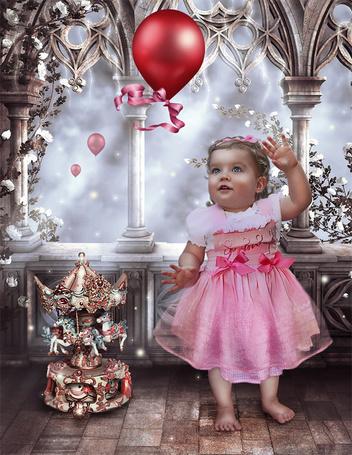 Фото Девочка играет с шариком на Рождество (Cindy Grundsten)