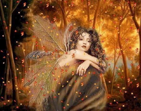 Фото На девушку с тонкими крыльями сыпется осенняя листва