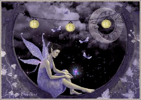 Фото В ночной тишине вокруг девуши-эльфа летают стрекозы