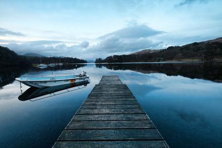 Фото Пирс и лодка на спокойном озере (Mark Nelson) (© Radieschen), добавлено: 07.01.2012 08:53