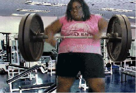 Фото Чёрнокожая полная женщина ,проводит упражнения с штангой (© BRODJaGA), добавлено: 15.02.2012 21:21