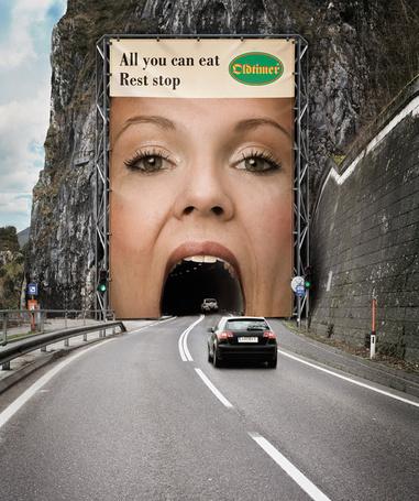 Фото Необычная реклама ресторана Oldtimer: Рот девушки - тоннель, самые креативные билборды мира (All you can eat Rest stop)
