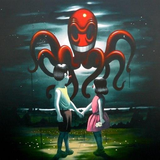 Фото Мальчик с девочкой смотрят на большого красного осьминога в небе (Victor Castillo)
