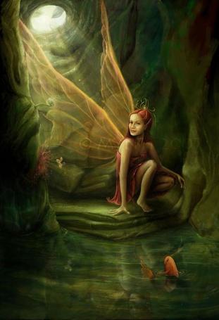 Фото Юная эльфийка разговаривает с золотыми рыбками