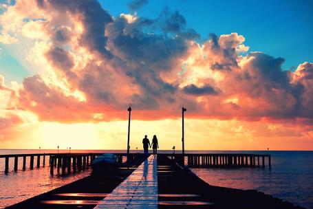Фото Влюблённая пара на морском причале, фотограф - Isac Goulart