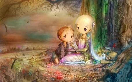 Фото Девочка читает мальчику книгу в волшебном лесу