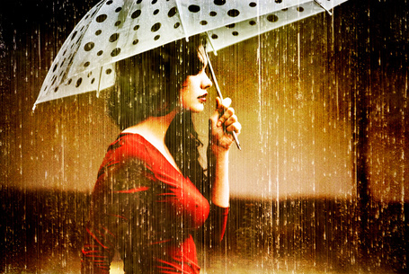 Фото Девушка с зонтиком под дождём. Фотограф Metin Demiralay (© Natko), добавлено: 13.05.2012 13:10