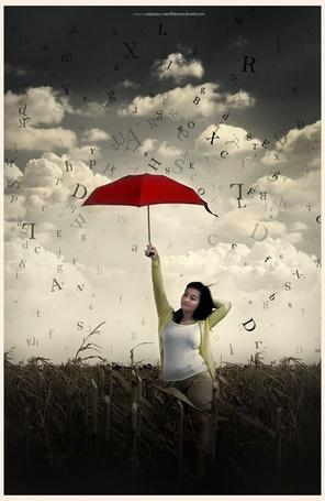 Фото Девушка стоит на кукурузном поле с красным зонтом под дождем из английских букв