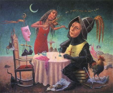 Фото Женщина играет на скрипке рыцарю, сидящему за столом