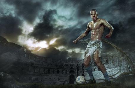 Фото Футболист с мячом на стадионе в Колизее
