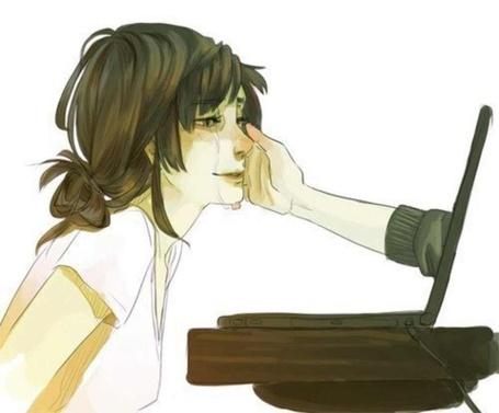 Фото Девушка плачет, протянутая рука помощи из экрана вытирает ей слезы