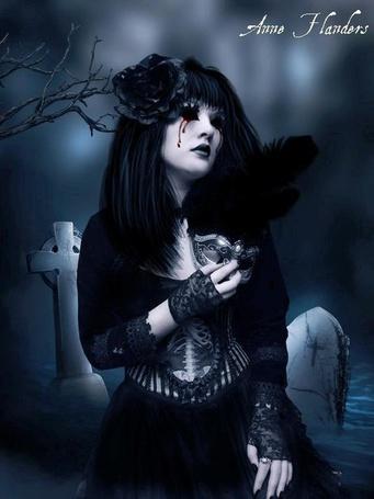 Фото Вампирша на кладбище с маскарадной маской в руке (Anne Handers)