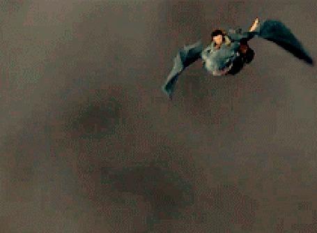 Фото Доисторический монстр извергает пламя, нападая на Иккинга, который летит верхом на драконе Беззубике - мультфильм Как приручить дракона / How to Train Your Dragon