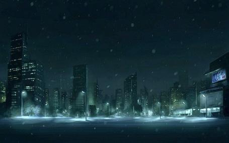 Фото Ночной город, с высотными зданиями ночью во время снегопада