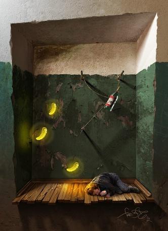 Фото Мужчина лежит на полу в почти разрушившемся подъезде, над ним висит бутылка водки и летают соленые огурчики, работа Сергея Свистунова