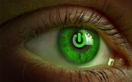 Фото Символ включения в зеленом глазу девушки