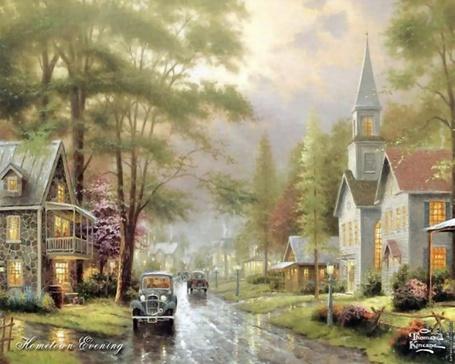 Фото Машины едут по дороге в пригороде, по бокам стоят маленькие коттеджи
