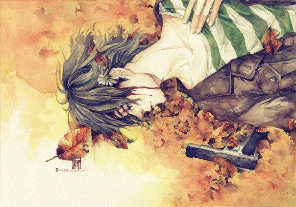 Фото Застреленный в висок парень лежит на осенних листьях, рядом валяется пистолет