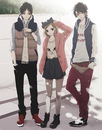 Фото Двое парней и девушка стоят на улице
