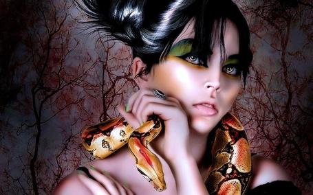 Фото Девушка с зелеными тенями на глазах , со змеей на шее , держит змею рукой (© Akela), добавлено: 28.02.2013 13:02