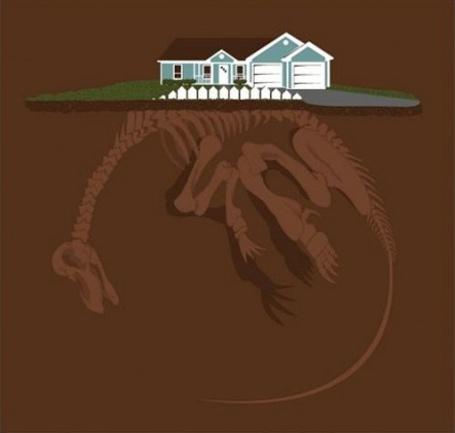 Фото Забор возле дома - из позвонка скелета огромного динозавра, что находится под землей