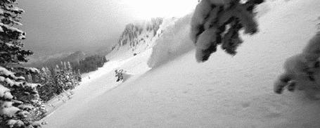 Фото Лыжник, съезжающий с гор