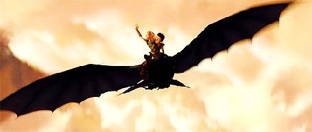 Фото Девочка с поднятой рукой и мальчик летят на драконе, отрывок с мультфильма Как приручить дракона / How to Train Your Dragon