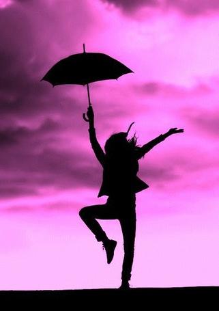 Фото Силуэт девушки с зонтиком