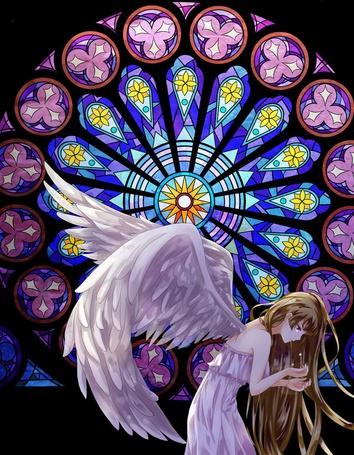 Фото Девушка ангел нагнувшись плачет протянув руки на фоне рисунков на стекле