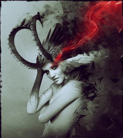 Фото Обнаженная девушка с рогами и крыльями и красным дымом у глаз